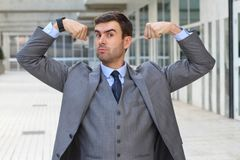 Elegant funny businessman flexing his muscles.  Royalty Free Stock Photos