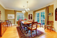 Elegant furnished dining room with wooden rustic dining table se Royalty Free Stock Images