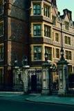 Elegant gate entrance to the old building / mansion. London, United Kingdom. Beautiful old elegant building with white tower. London, United Kingdom Royalty Free Stock Photo