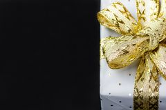 Elegant Gift Box Wrapped in Grey Paper with Polka Dots Golden Ribbon. Christmas New Years Valentine Royalty Free Stock Photos