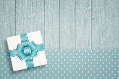 Elegant gift lying on dotted tablecloth Stock Image
