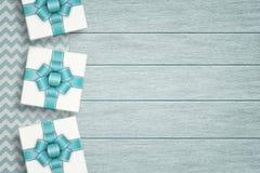 Elegant gifts lying on zigzag tablecloth Stock Photos