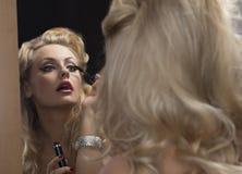 Elegant girl applying mascara Royalty Free Stock Image