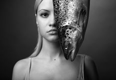 Elegant girl with big fish. Fashionable elegant girl with big fish on dark background Royalty Free Stock Photo