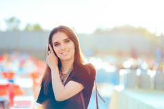 Beautiful Woman in All Black Outfit Attending Outdoor Party Stock Photo