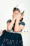 The elegant girl cries. The elegant girl shut the face with the hands Royalty Free Stock Images