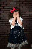 The elegant girl cries. The elegant girl shut the face with the hands Royalty Free Stock Photography