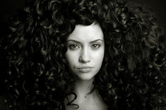 Elegant girl with curly hair Stock Photos