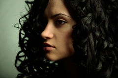 Elegant girl with curly hair Royalty Free Stock Photography