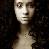 Elegant girl with curly hair Royalty Free Stock Images