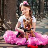Elegant girl  with a dog Stock Images