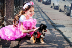 Elegant girl  with a dog Royalty Free Stock Images