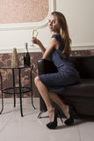 Elegant girl drinking champagne stock photos
