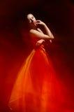 Elegant girl in fluttering red dress Royalty Free Stock Image