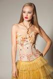 Elegant girl in gold dress Stock Photos