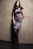Elegant girl in grey dress Stock Photo