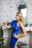 Elegant Girl in luxurous blue dress. Christmas decor Royalty Free Stock Images