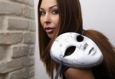 Elegant girl with mask Royalty Free Stock Image