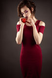 Elegant girl with nectarine in hands Royalty Free Stock Image
