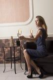 Elegant girl offering champagne Stock Images