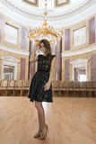 Elegant girl in old auditorium Royalty Free Stock Photography