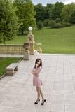 Elegant girl outside in park Royalty Free Stock Image