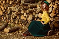 Elegant girl in a park Royalty Free Stock Image