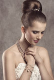 Elegant girl with pearls Royalty Free Stock Image