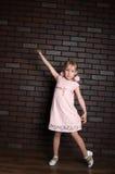 Elegant girl in a pink dress Royalty Free Stock Image