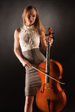Elegant girl playing on cello. Studio isolated shot Royalty Free Stock Photography