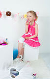 Elegant girl playing with cosmetics and jewelry Royalty Free Stock Photography