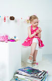 Elegant girl playing with cosmetics and jewelry Royalty Free Stock Images