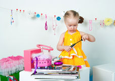 Elegant girl playing with cosmetics and jewelry Stock Image