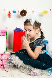 Elegant girl playing with cosmetics and jewelry Royalty Free Stock Photo