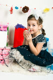 Elegant girl playing with cosmetics and jewelry Royalty Free Stock Image