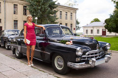 Elegant girl poses near retro car Stock Image