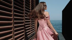 Elegant Girl In Prom Dress Is Posing Near Seaside Hotel Building On Happy Summer Day.