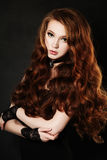 Elegant Girl with Red Curly Hair Royalty Free Stock Photography