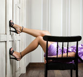 Elegant girl's legs Stock Images
