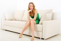 Elegant girl on sofa Stock Photos