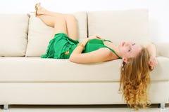 Elegant girl on sofa Royalty Free Stock Image