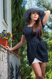 Elegant girl in a summer hat outdoors Stock Image