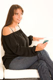 Elegant Girl telephoned. Elegant woman phoned on the couch with the phone Royalty Free Stock Photography