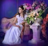 Elegant girl in white dress Stock Images