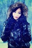 Elegant girl in winter jacket Stock Photos