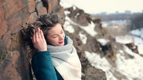 Elegant girl in the winter in the mountains near the city stock video