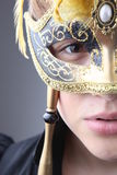 Elegant girl with a wonderful mask Stock Photos
