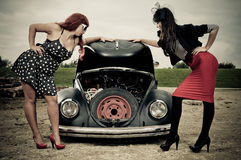 Elegant girls and car trouble Royalty Free Stock Photo