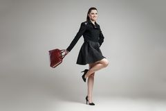 Elegant glamour woman wearing black skirt and Royalty Free Stock Photo