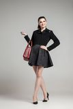 Elegant glamour woman wearing black skirt and Stock Photography
